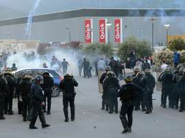 French anti-riot policemen scatter Bastias supporters outside the stadium