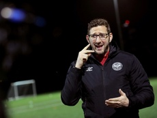 Football coach proves deafness is no hindrance to career on touchline. AFP