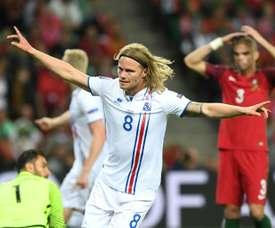 Icelands midfielder Birkir Bjarnason celebrates the teams first goal during the Euro 2016 match against Portugal in Saint-Etienne on June 14, 2016