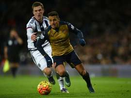 West Bromwich Albions Craig Gardner challenges Arsenals Alexis Sanchez during the match at The Hawthorns in West Bromwich, England on November 21, 2015