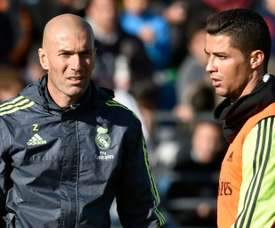 Real Madrids new head coach Zinedine Zidane (L) talks to Cristiano Ronaldo during his first team training session, at the Alfredo di Stefano stadium in Valdebebas, on the outskirts of Madrid, on January 5, 2016