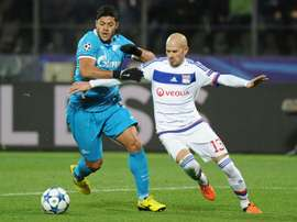 Zenits Brazilian forward Hulk (L) vies for the ball with Lyons French defender Christophe Jallet during the UEFA Champions League group H football match at the Petrovsky stadium in St. Petersburg on October 20, 2015