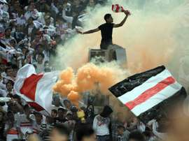 Egyptian fans of Zamalek club celebrate during a match on November 10, 2011