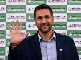 Colombia football player Mario Alberto Yepes poses for pictures during a press conference in Cali, Colombia, on January 20, 2016, where he announced his retirement as a footballer after 21 years in the profession