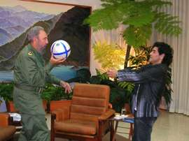 Cuban President Fidel Castro (L) plays with a football with Argentinian former football star Diego Armando Maradona, during the recording of Maradonas TV program The 10s Night in Havana, 26 October 2005
