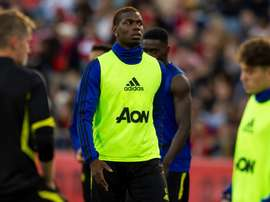 Pogba will not play against AC Milan due to back spasm. AFP