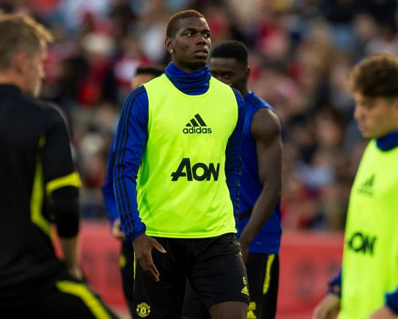 Pogba hasn't lost all hope on a move. AFP