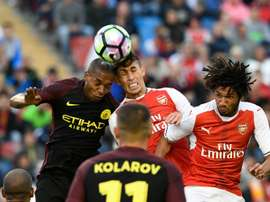 Arsenals defender Gabriel (C) jumps for the ball with Manchester Citys midfielder Fernando (L) during a friendly football match at the Ullevi stadium in Gothenburg on August 7, 2016