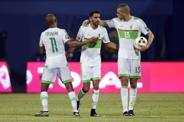 Algeria's Riyad Mahrez (C) celebrates with Yacine Brahimi (R) and Islam Slimani. AFP