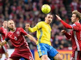 Swedens forward and team captain Zlatan Ibrahimovic vies with Denmarks defender Lars Jacobsen (L) during the Euro 2016 second leg play-off football match at Parken stadium in Copenhagen on November 17, 2015