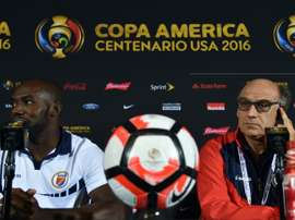 Patrice Neveu (R), coach of the Haitis mens team, with football player Jean Marc Alexandre during a press conference in Orlando, Florida on June 7, 2016