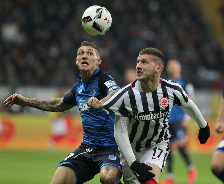 Hoffenheims midfielder Steven Zuber and Frankfurts striker Ante Rebic (R) vie for the ball during the German first division Bundesliga football match December 9, 2016