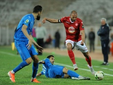 A file photo of Etoile Sahel midfielder Yassine Chikhaoui (R). AFP