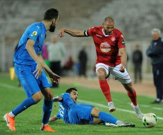 A file photo of Etoile Sahel midfielder Yassine Chikhaoui (R). AFP