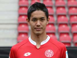 Mainz Japanese striker Yoshinori Muto poses for a photo during the team presentation in Mainz, western Germany, July 12, 2015