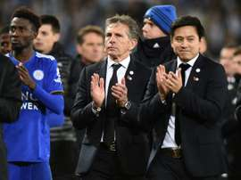Leicester City manager Claude Puel (centre) applauds fans after Burnley draw. AFP