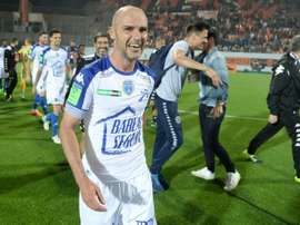 Troyes midfielder Benjamin Nivet celebrates at the end of the play-off match against Lorient