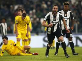 Juventus forward Gonzalo Higuain celebrates after scoring against Dinamo Zagreb. AFP