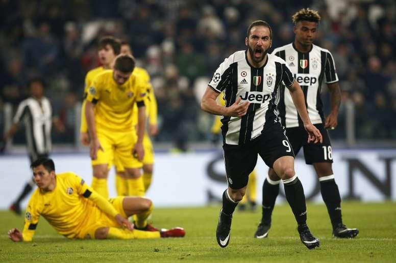 Juventus forward Gonzalo Higuain celebrates after scoring against Dinamo Zagreb. AFP