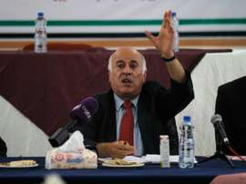 Palestinian Football Association President Jibril Rajoub speaks during a meeting in the Israeli-occupied city of Hebron announcing a decision to postpone a rare match between teams from the Gaza Strip and the West Bank, on July 30, 2016