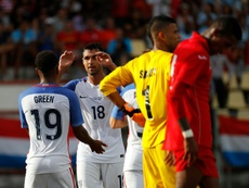 Chris Wondolowski (No. 18) of the US celebrates with teammate Julian Green after he assisted Greens goal against Cuba, at Estadio Pedro Marrero in Havana, on October 7, 2016