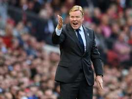 Koeman will be hoping Everton can continue their rediscovered form on Thursday evening. AFP