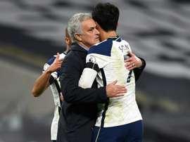 Tottenham manager Jose Mourinho (L) hugs Son Heung-min. AFP