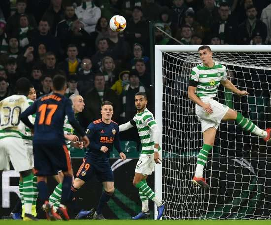Lille would like to buy Simunovic (R) off Celtic. AFP