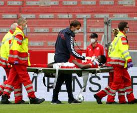 Awoniyi was knocked out cold during Mainz's clash against Augsburg. AFP