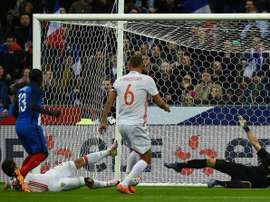Frances midfielder NGolo Kante (2nd L) scores the opening goal during the international friendly football match against Russia at the Stade de France in Saint-Denis, north of Paris, on March 29, 2016