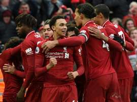 Liverpool celebrate the late goal against Spurs. AFP