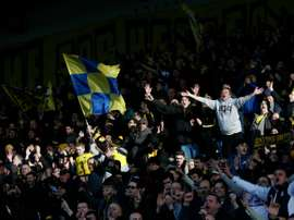 Oxford fans celebrate their teams victory at the final whistle following the FA Cup third-round football match between Oxford United and Swansea City at the Kassam Stadium in Oxford, west of London, on January 10, 2016