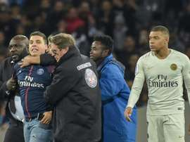 Snap judgment: fan who took selfie with Mbappe fined and banned. AFP