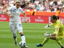 Kelly Smith (L) scored 46 goals in 117 appearances for England and won five FA Cups. AFP