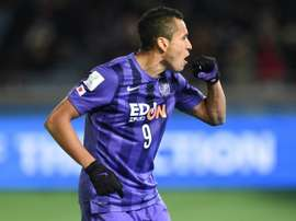 Sanfrecce Hiroshima forward Douglas celebrates after scoring against Guangzhou Evergrande during the third-place match at the Club World Cup in Yokohama, on December 20, 2015