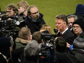 Manchester United beat Shrewsbury in the FA Cup but manager Louis van Gaal (R) remains a man facing problems