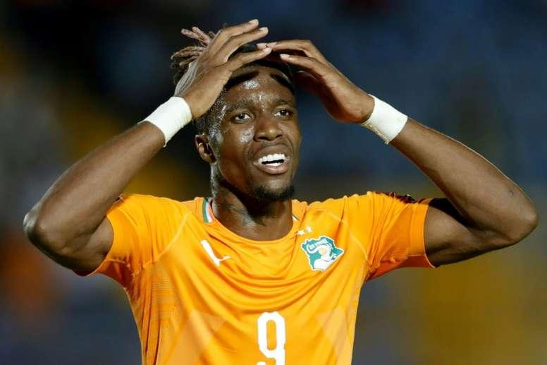 Hodgson expecting disgruntled Zaha to shine again for Palace. AFP