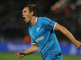 Zenits Russian forward Artem Dzyuba celebrates a goal during a UEFA Champions League group H football match against Gent at the Petrovsky stadium in St. Petersburg on September 29, 2015