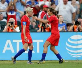 Megan Rapinoe (L) will not be at the NWSL tournament in Utah due to COVID-19 concerns. AFP