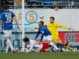 Hamburgs (2nd L) Michael Gregoritsch scores during the match between Darmstadt 98 and Hamburg. AFP