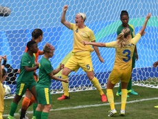 Swedens Nilla Fischer (C) celebrates her goal against South Africa. AFP