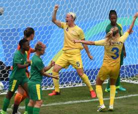 Sweden's Nilla Fischer celebrates scoring in the Rio 2016 Olympics. AFP