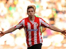 Athletic Bilbaos forward Iker Muniain celebrates after scoring during the Spanish league football match against Real Betis Balompie at the Benito Villamarin stadium in Sevilla on February 23, 2014