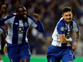 Moussa Marega and Alex Telles after scoring in the Champions League Last 16. AFP