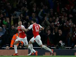 Arsenals defender Kieran Gibbs (L) celebrates with Olivier Giroud after scoring during an English Premier League football match at the Emirates Stadium in London on November 8, 2015