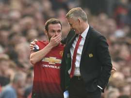 Mata (l) will stay at Man Utd for at least another two seasons. AFP
