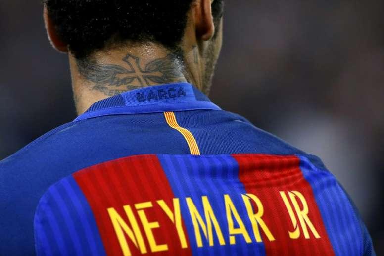 Jogadores do Barça colocaram dinheiro por Neymar. AFP