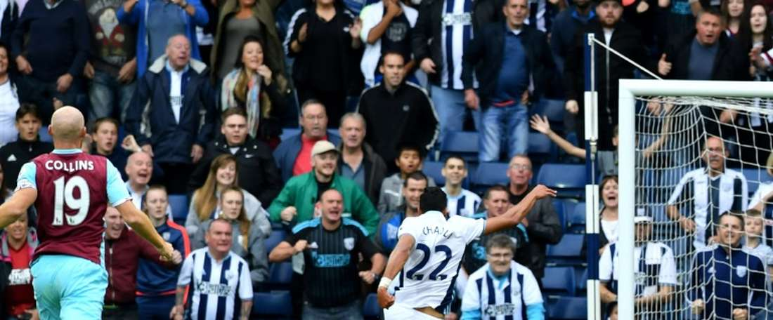West Bromwich Albions midfielder Nacer Chadli (R) scores their fourth goal during the English Premier League football match between West Bromwich Albion and West Ham United at The Hawthorns stadium on September 17, 2016