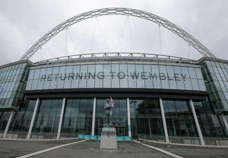 FA announces 82 redundancies as it braces for loss of £300m. AFP
