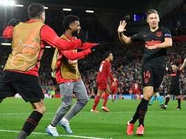 Llorente double stuns Liverpool to take Atletico into quarter-finals. AFP